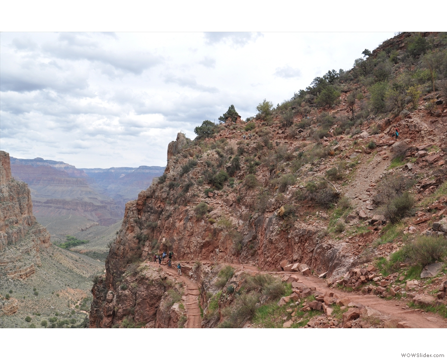 The trail descends swiftly via a series of switchbacks down the side of the promontory...
