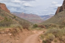 By now, the trail has reached the valley bottom and from here it's a shallow descent to...