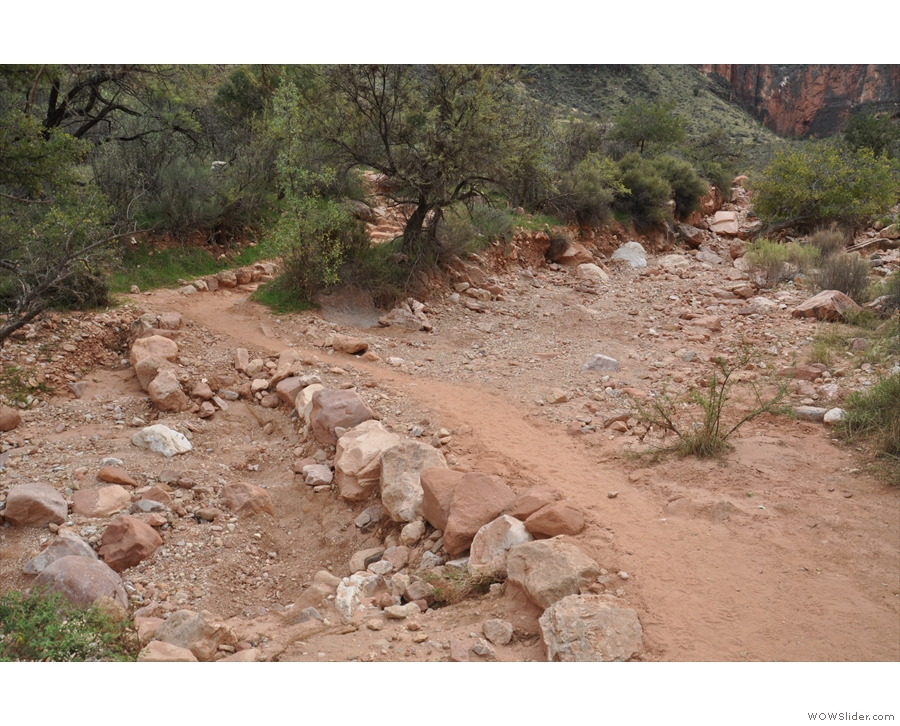 The trail crosses the dry steam bed of the Garden Creek...