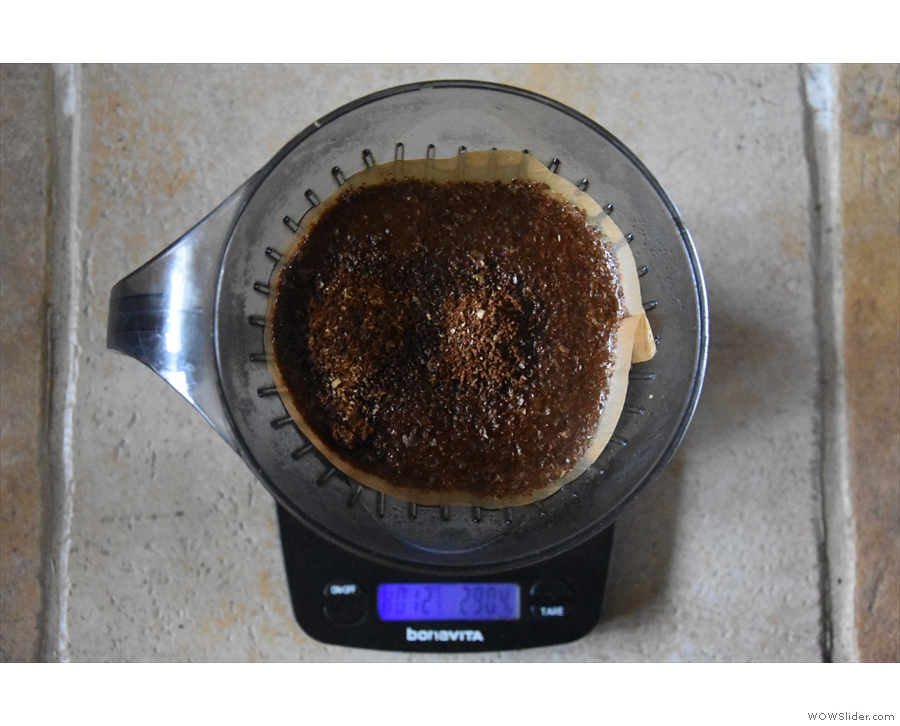 Put the ground coffee in next (in this case, 16.5 grams) and start the timer.