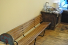 More seating: a garden bench opposite the counter.