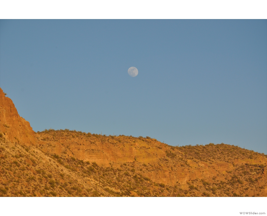 Check out the moon over the mountains on the northern side of the lake.