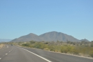 SR 87 goes north through big mountain country. First it skirts the mountains...
