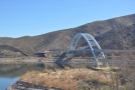 The Roosevelt Lake Bridge spans the gap where the Salt River flows into the mountains.