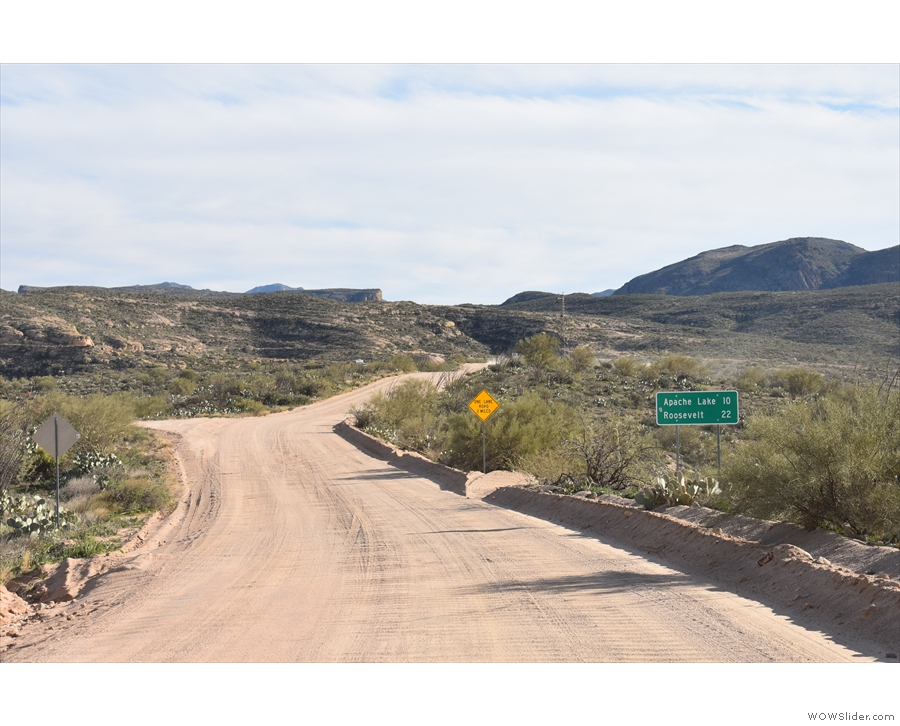 ... a dirt track for the rest of the way, which, as the sign says, is only...
