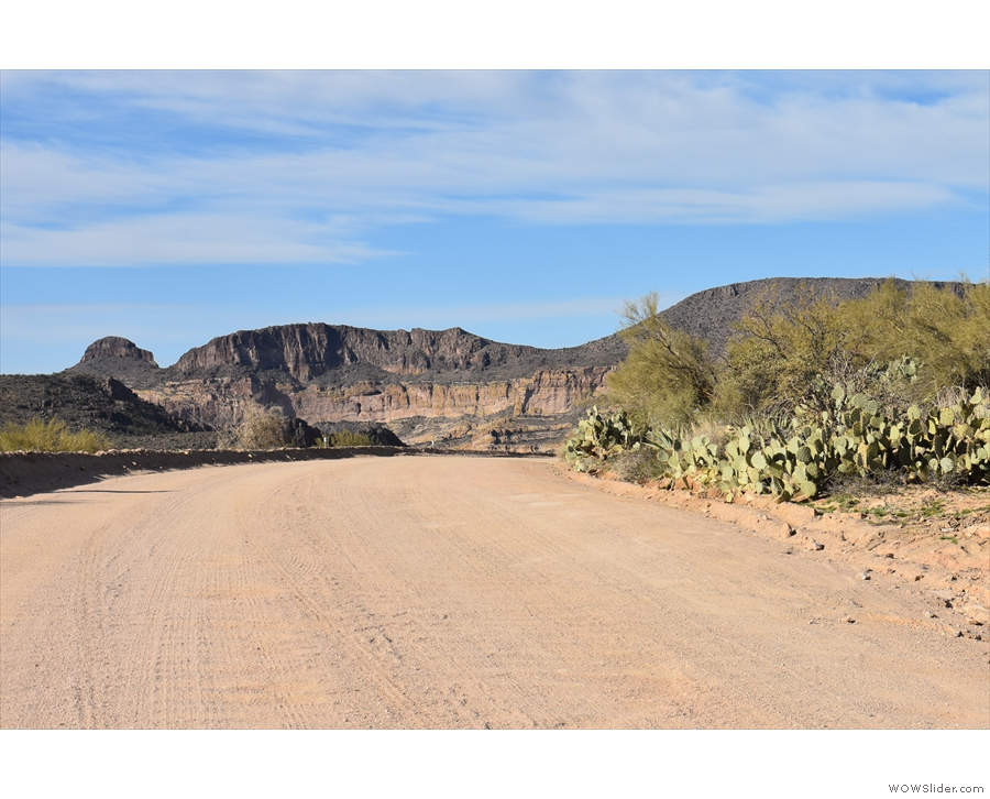Although it's unpaved, it's still a wide, flat road, which climbs up to my next stop...