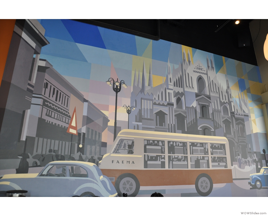 This amazing mural, by local artist David Guinn, adorns the wall to the right of the counter.
