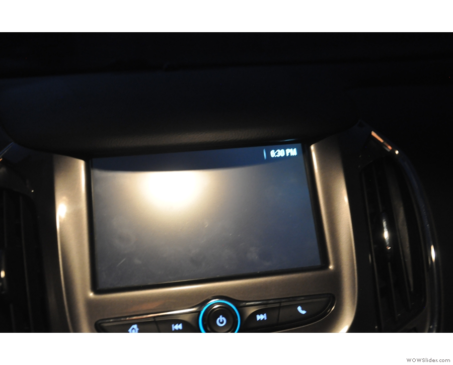 A quick glance at the clock in the car shows that it's 18:30.