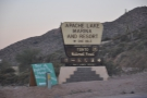 However, a kilometre further on, you reach a paved road to the lake with a big sign.