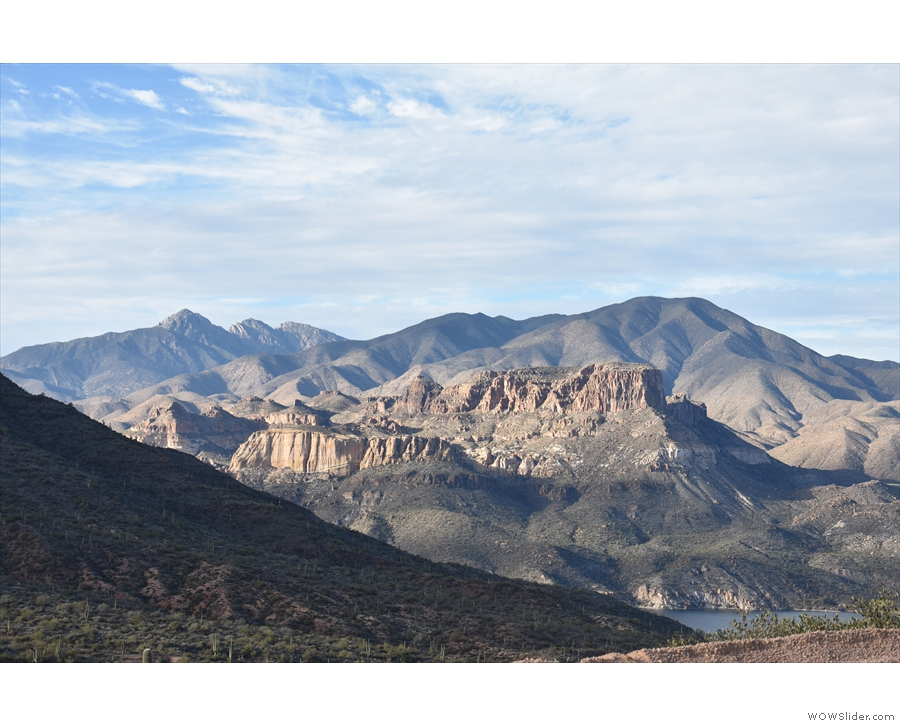 ... as Apache Lake comes into view, with the amazing rock formations towering above it.