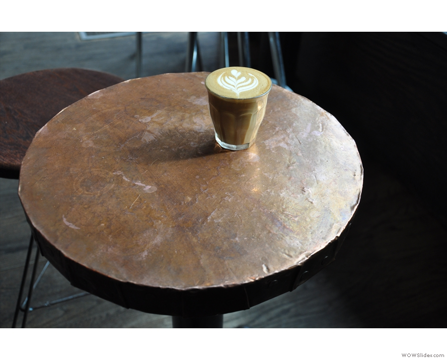 My cortado on one of the lovely metal-topped tables.