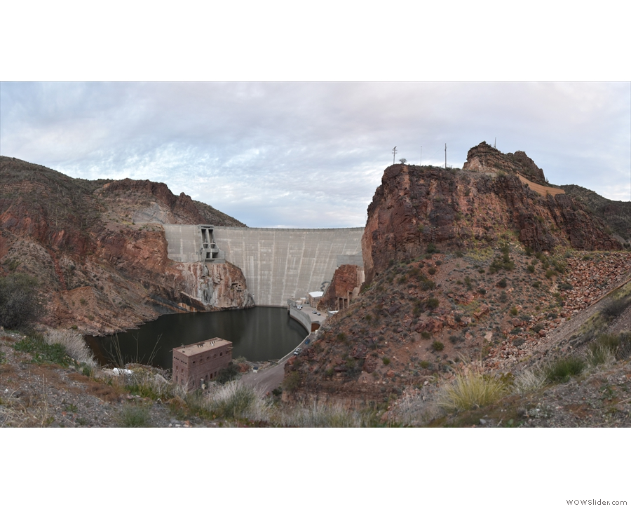 A panoramic view from the overlook, high above the water, but below the dam's rim.