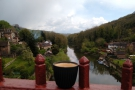 Here's my coffee on the bridge, enjoying the view, looking east, down the river.