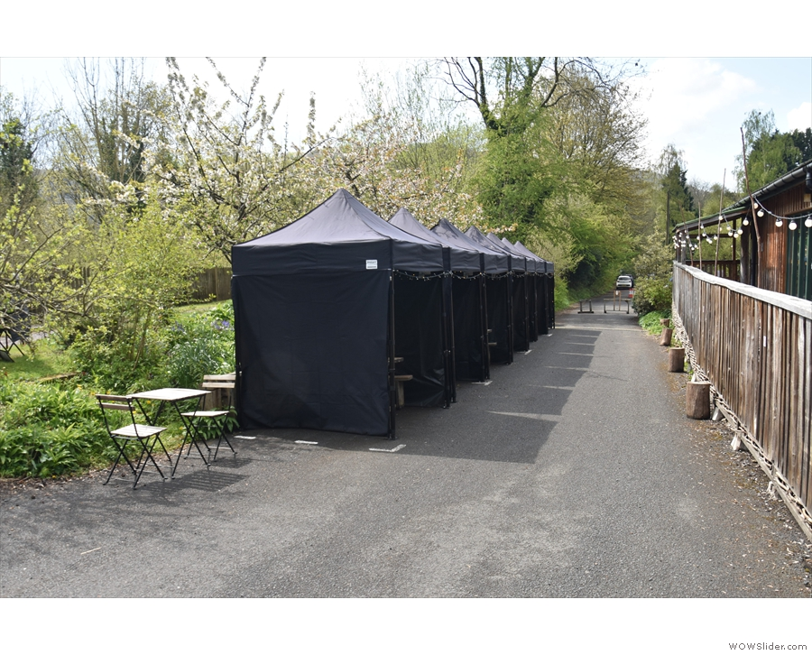 ... and you'll find a row of seven gazebos opposite the café, plus a two-person table.