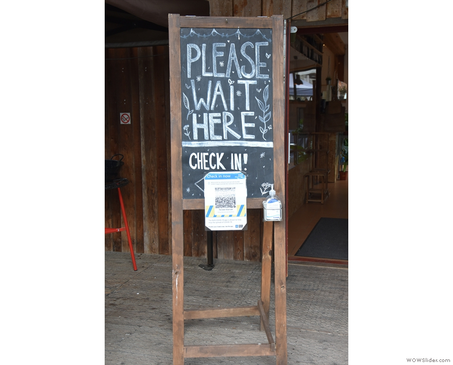 ... where you are greeted by a sign asking you to wait to be seated.