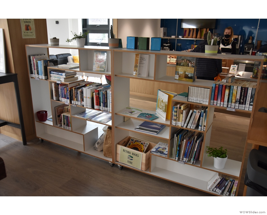 Once you are done, head back outside, this bookcase separating you from the counter.