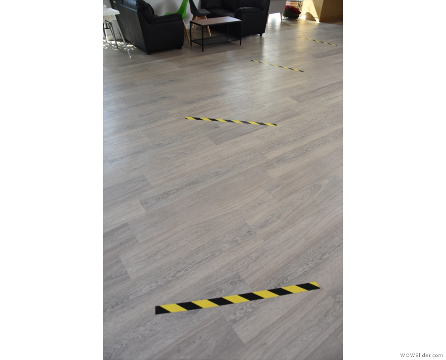 For now, though, the bare floor just has the COVID-19 social distance markers...