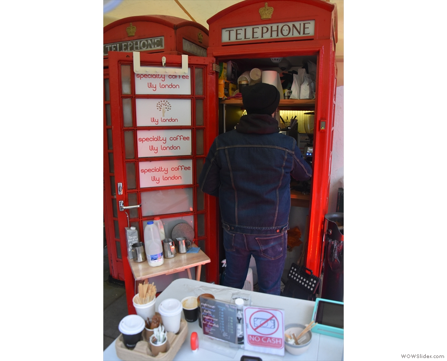 ... and operating out of one of the pair of old telephone boxes there.