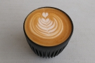 ... regular milk in my flat white, seen here in my HuskeeCup, with some awsome latte art...