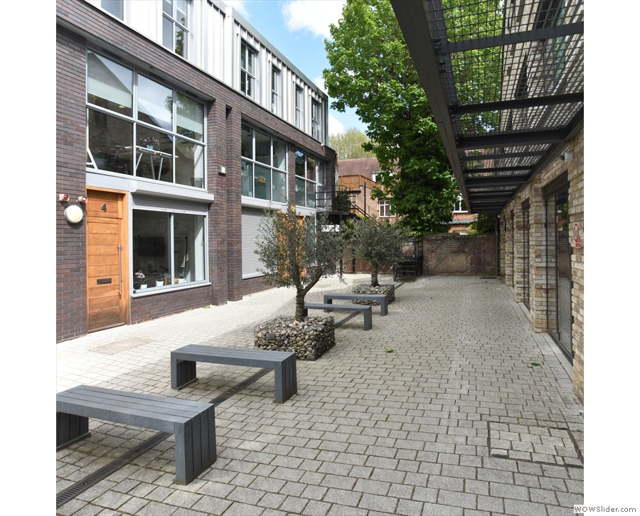 The Mews also continues, with a line of six benches down the middle.