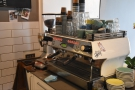 The La Marzocco FB80 espresso machine is to the right, facing the front of Chief Coffee...