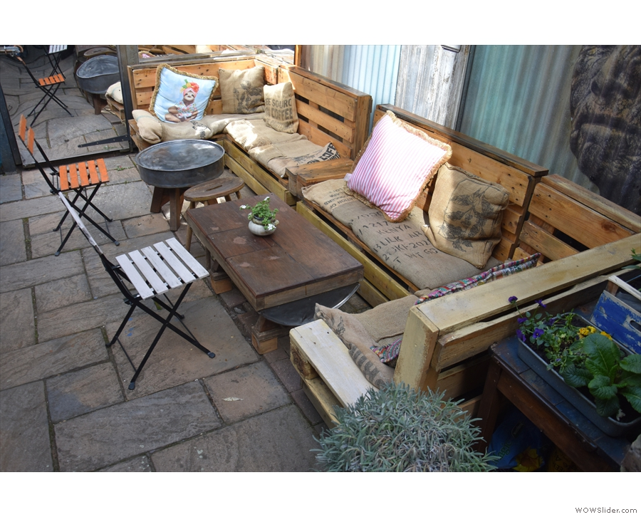 The sofa-benches in more detail. There are plenty of cushions, covered in old coffee sacks.