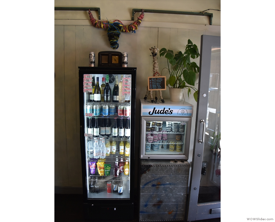 Opposite this, by the door, are chiller cabinets with more drinks and ice cream.
