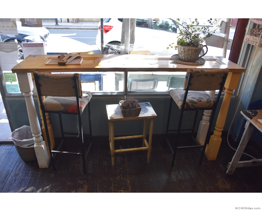 For now, there's just this table made of an old door in the window.
