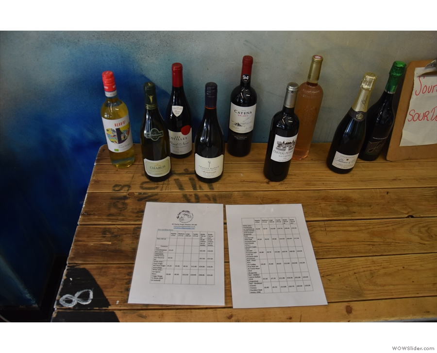 ... with the selection of wines on a table below.