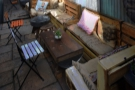 There are a pair of L-shaped sofa-benches (made of old pallets) on the right...