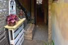 ... which leads to this porch (view from the outside). Turning around again, there it is...