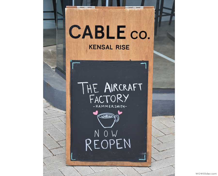 ... and an A-board announcing Cable Co.'s reopening after a COVID-19 enforced closure.