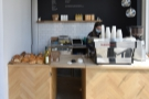 ... with the counter at the far end. The menu is on the wall behind/above the counter...