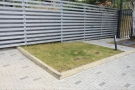 ... there are plans to put deckchairs on this small piece of grass to the right of the gates.