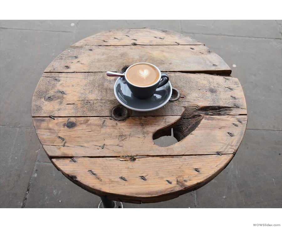 ... which I enjoyed sitting on one of the stools outside...