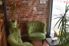On the right, between counter and window, is this cosy seating area with two armchairs.