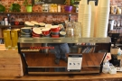 At the other end of the counter is the La Marzocco Linea espresso machine.