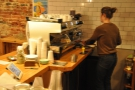 Meanwhile April is hard at work on the espresso machine, serving other customers.
