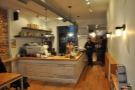 The counter is in the middle of the store, espresso to the left, pour-over on the right.
