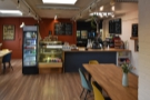 The counter, where you order and collect your coffee, is still at the back on the right.