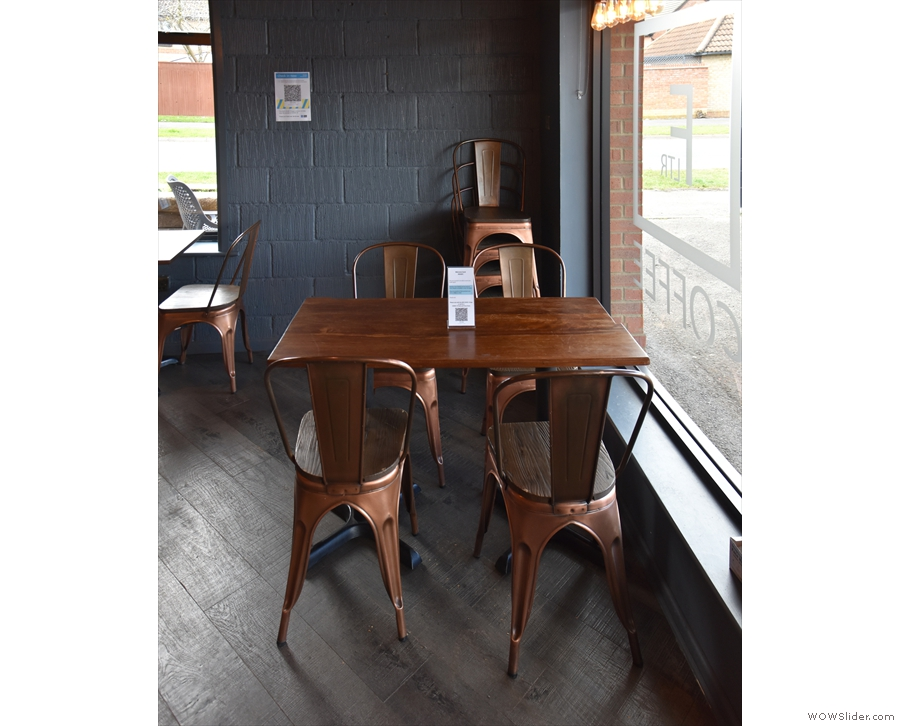 ... starting with this four-person table in the window.