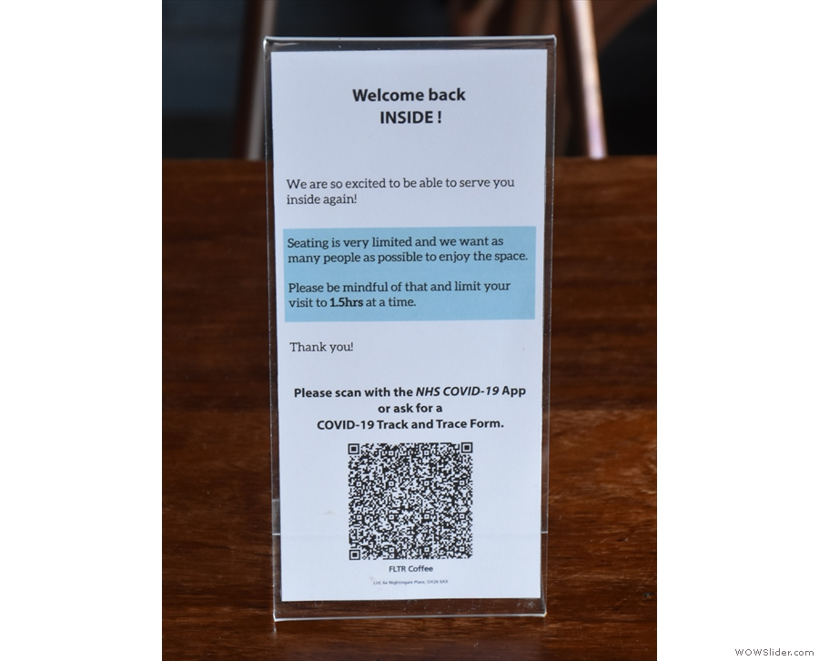 A sign of the (COVID-19) times and the obligatory NHS App QR Code.