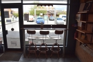 The only seating in the left-hand part of FLTR Coffee is this three-person window-bar.