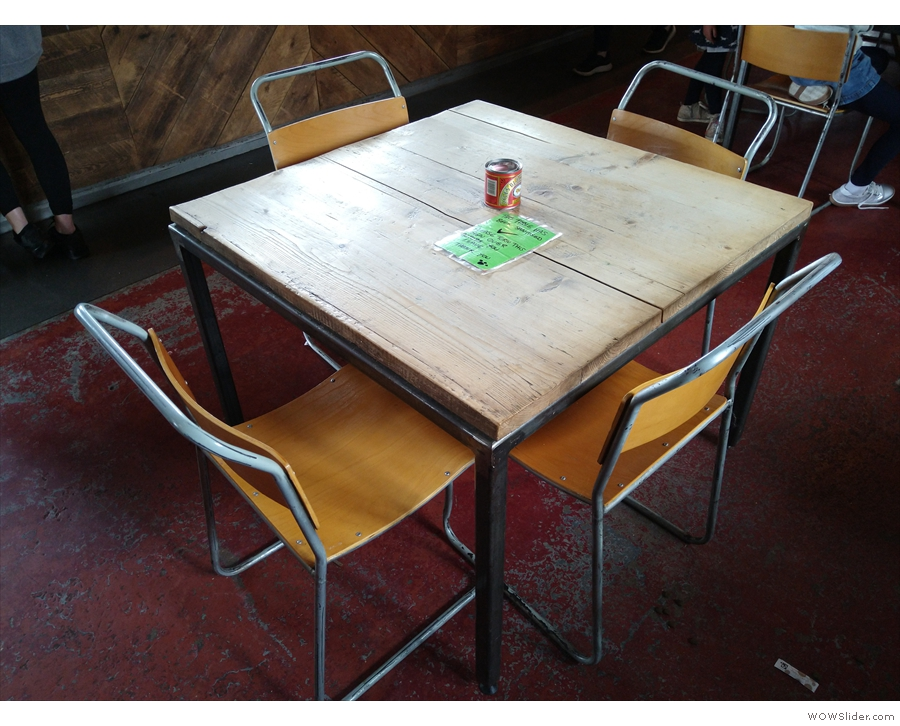 This four-person table is one of three tables that run in a row down the middle.