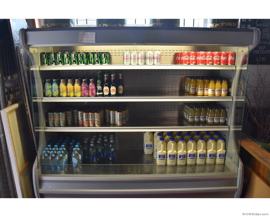 Meanwhile, there are soft drinks and milk for sale on the left.