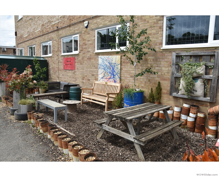 ... and then there's this neat garden-like area with a picnic table and more benches.