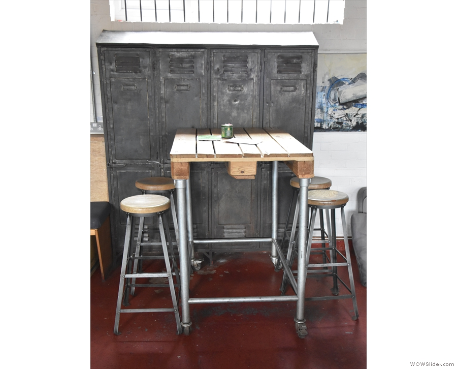 Opposite it, against the right-hand wall, is this high, four-person table...