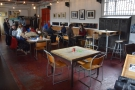 ... while there's some conventional table seating on the right, opposite the counter.