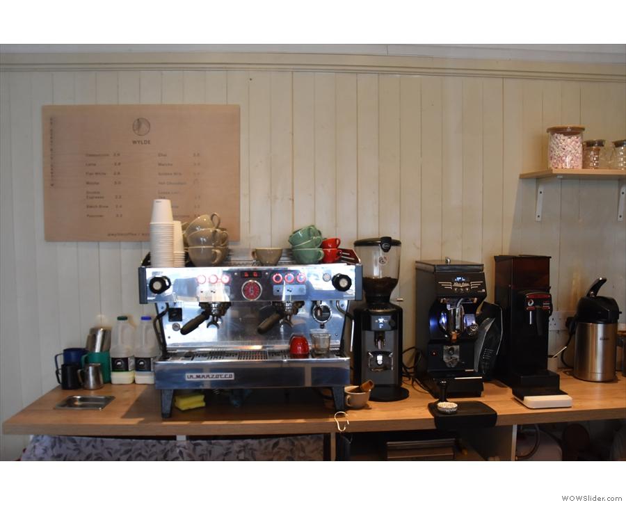 ... while the La Marzocco espresso machine is behind the counter...