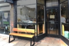 There is a pair of benches outside, one in front of each of the windows...